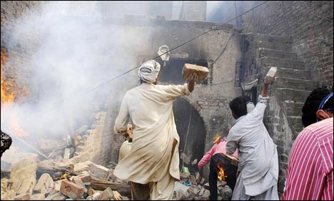 Muslim mob burn down and destroy entire Christian neighborhood for blasphemy charge claimed to be false.