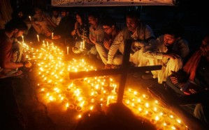 Pakistanis light candles to express their solidarity with the victims of a suicide attack on a church in Lahore Photo: AP