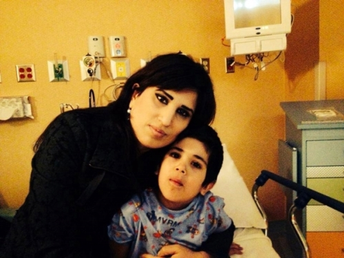 Pastor Saeed's son in the Hospital before surgery with his mother, Naghmeh Abedini