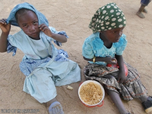 Displaced Refugees Children Eating Rice on Christmas Day- DEC. 25,2013