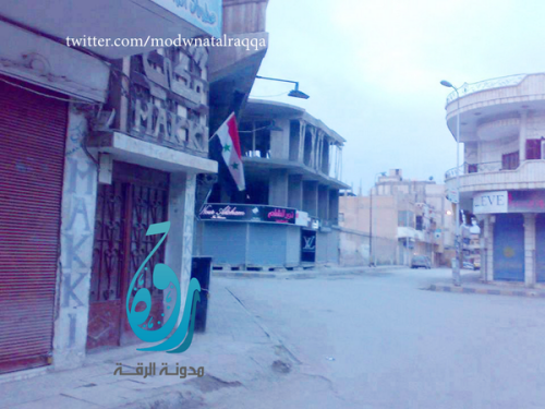 Regime flag recently put up in Raqqa city.