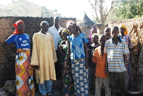 Christians gather near destruction on their village
