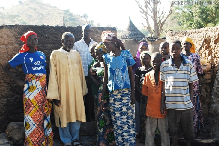 Christians gather near destruction on their village