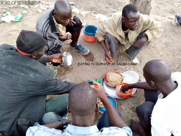 Left homeless, Christians  sharing food at refugee camp