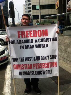 Christian-Arab-sign-carrier