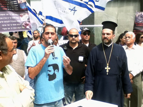 Father Gabriel Nadaf at right appears at rally calling for the West to protect Christians in Islamic countries  (Photo: Christian Lobby)