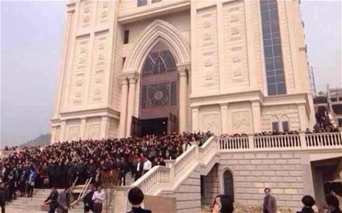 Thousands of Chinese Christians have mounted an extraordinary defence of a church in a city known as the 'Jerusalem of the East'