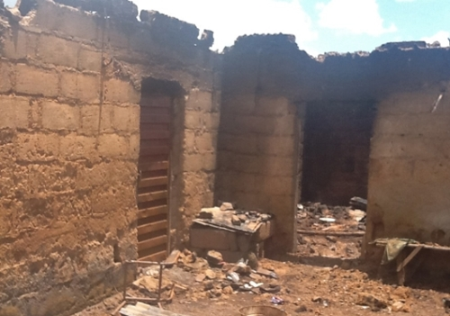 Charred home of the slain Gideon Mutang Kidum. Photo: Morning Star News