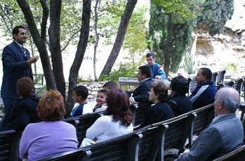Pastor Steven Khoury preaching at service at Garden Tomb in 2007. Courtesy of Steven-Khoury