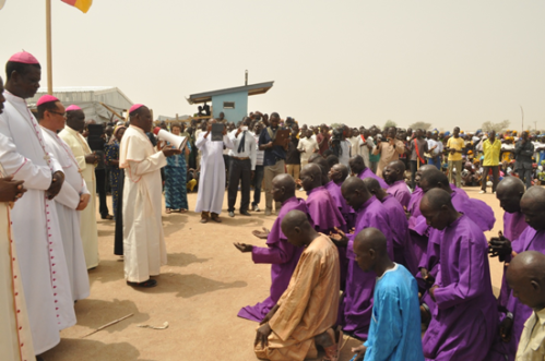Bishop Doeme of Maiduguri along side other Bishops prays for the Refugees at Maroua camp