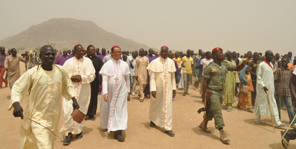 The Nigerian delegation marching into Maoura camp: Bishop Ugorj(Umuahia); Bishop Manza (Yola) and Bishop Doeme(Maiduguri)