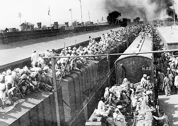 MILLENNIUM PHOTO: FREEDOM MOVEMENT, HISTORY'S BIGGEST MIGRATION. TRAIN LOADED TO CAPACITY, INDIA PAKISTAN PARTITION.. ISSUED BY DIRECTORATE OF PUBLIC RELATIONS, EAST PUNJAB. Photo: en.wikipedia.org
