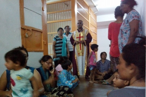 Pastor Joshua is amongst frightened children detained with their families. Photo: courtesy BPCA