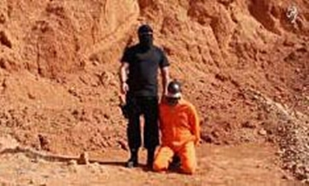 Screenshot from video showing beheading. (YouTube)