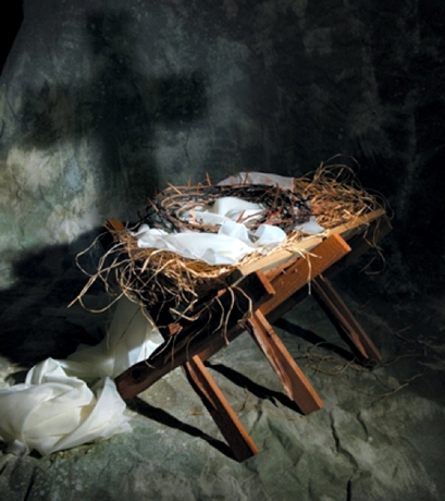 The story of Christmas represented by the birth of Jesus and his death on the cross.