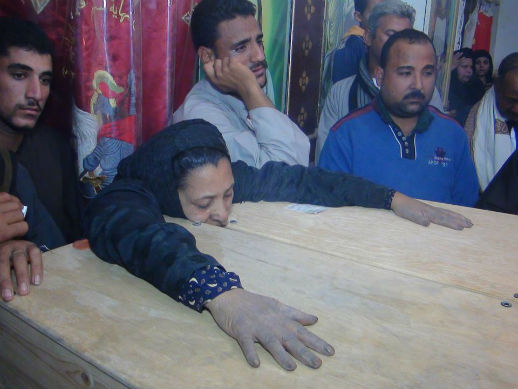 The family's final plea is for rest after the ordeal of receiving the bodies Mother of the two slain copts during the funeral - WWM