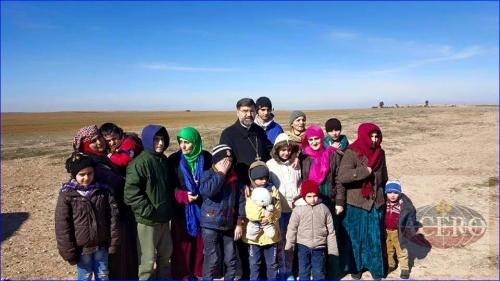 Bishop Aprim with the Assyrian hostages from Khabur who were released today by ISIS. Photo: AINA