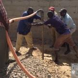 Well drillers work hard soil