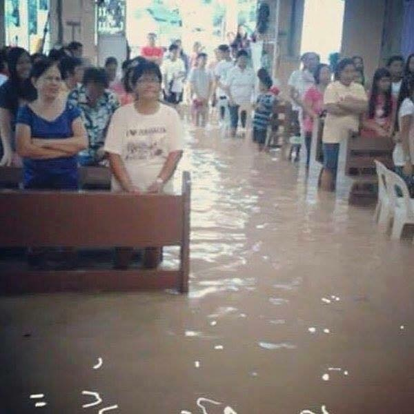 Christians in Philippines worship during flood. How many western churches are this hungry for the Word? God bless these brothers and sisters.