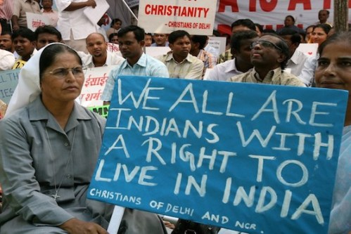 Indian Christians hold placards and banners during a protest in New Delhi on September 26, 2008, held to draw attention to continued anti-Christian violence in the southern Indian state of Karnataka and the eastern state of Orissa. Christian leaders in India have asked for the deployment of soliders in the restive states.   Some twelve people have died in Orissa's Kandhamai region and Karnatka since the death of Hindu Priest and Vishwa Hindu Parishad (VHP) leader Swami Lakshananananda Saraswait and four others who were shot dead by unidentified killers in Orissa in August. AFP PHOTO/RAVEENDRAN / AFP PHOTO / RAVEENDRAN