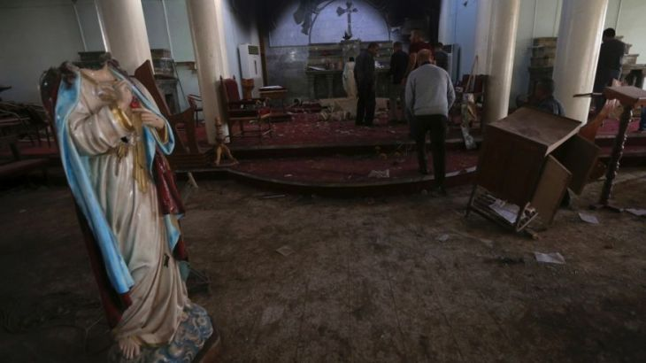 Nov. 13, 2016: Iraqi Christian citizens check the St. Addai church which was damaged by Islamic State fighters during their occupation of Keramlis village, less than 18 miles southeast of Mosul.  (AP Photo/Hussein Malla)